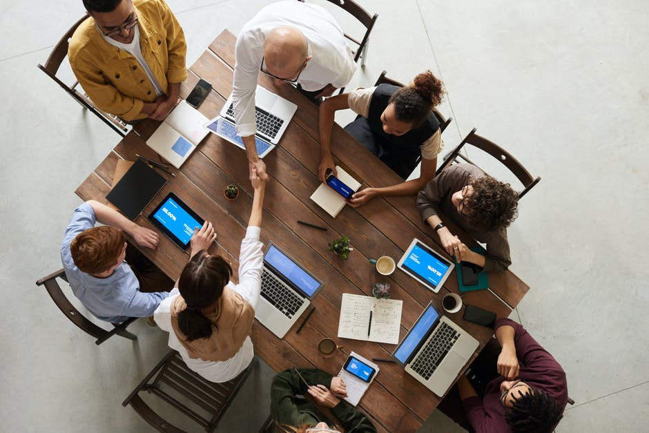 A group of people sitting at a desk